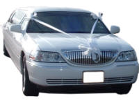 Cars for Stars (Staines) - Wedding Limo. White Lincoln stretched wedding limousine with white ribbons